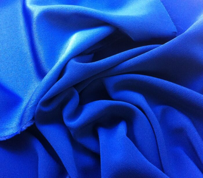Satin backed crepe dress fabric in Royal