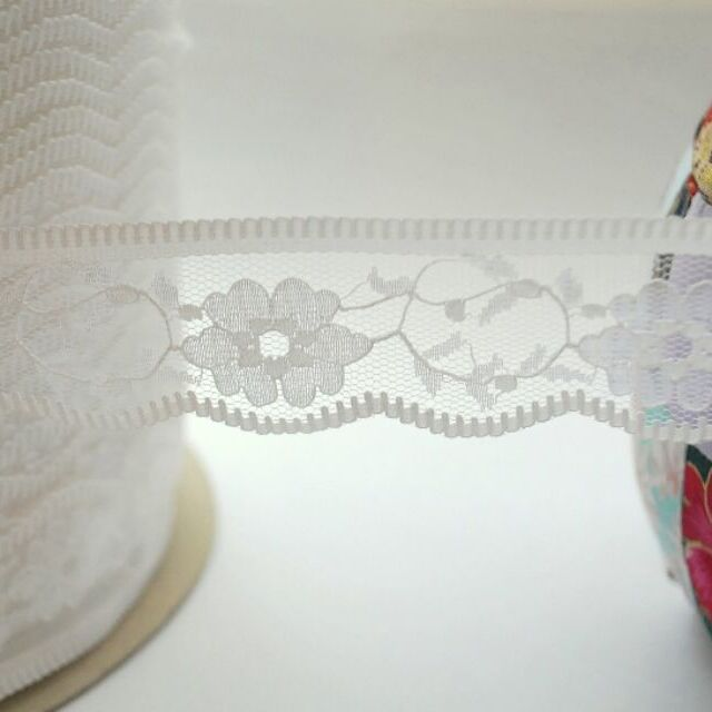 Photography of White polyester lace trim
