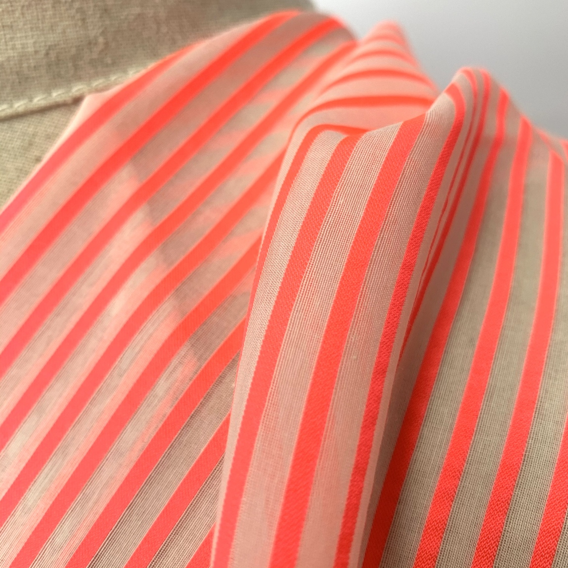Blouse Fabric In White With A Coral Stripe